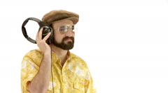 Young man dressing 70s yellow clothes talking into the microphone Stock Footage