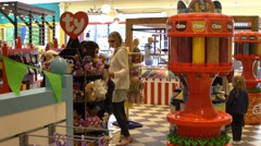 Adults and children in a candy store Stock Footage