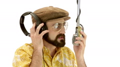 Young speaker man dressing 70s vintage clothes talks to microphone Stock Footage