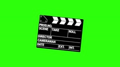A motion picture clapboard, also called a slate on green screen Stock Footage