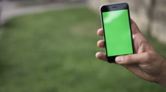 Holding Touchscreen Device, Close-up of female hands using a smart phone. chroma Stock Footage