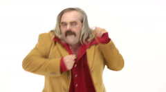 Middle age man dressing 70s brown red vintage clothes dances Stock Footage