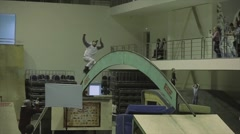 Roller skater with go pro in head roll on arch between springboards. Competition - stock footage