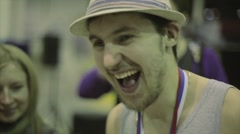 Happy roller skater in hat with medal on neck on stage on competition in Stock Footage