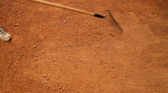 Raking dirt in preparation to lay sod. Stock Footage