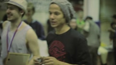 Man congrats roller skater in cap with winning on competition in skatepark Stock Footage