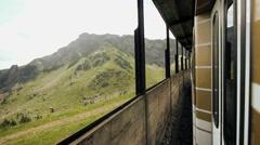 Train ride mountain landscape Stock Footage