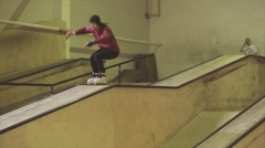 Roller skater in plaid shirt slide on springboard. Extreme hobby. Competition in - stock footage