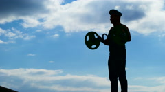 A military officer in a beret performs exercises with a barbell Stock Footage