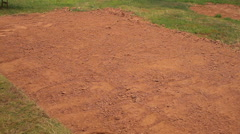 Pan of sod being rolled out onto fresh dirt. Stock Footage