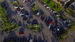 Aerial video parking lot revealing a shopping center Stock Footage