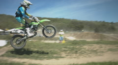 Enduro Motorcycle Riders Making Extreme Jumps and Tricks During the Stock Footage