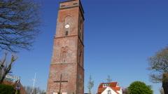 Oldest Lighthouse on Borkum island north sea coast germany Stock Footage