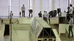 Roller skater jump from one springboard on another. Slip. Cameraman. Competition Stock Footage