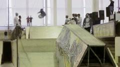 Roller skater jump from springboard, flip in air. Grab foot. Cameraman - stock footage