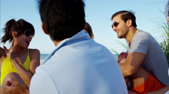 Smiling multi ethnic people in casual clothing enjoying party on beach holiday Stock Footage