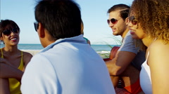 Caucasian American male playing the guitar and enjoying party on beach vacation Stock Footage