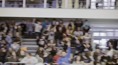 View at audience on tribune on competition in skatepark. Making wave. Cameraman - stock footage