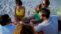 Multi ethnic people enjoying party with guitar and hanging out on beach holiday Stock Footage