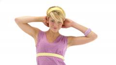 Young seductive woman dressing 70s purple vintage dress dances Stock Footage