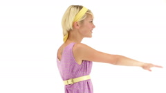 Young seductive woman dressing 70s purple vintage dress dances Stock Footage