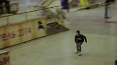 Young roller skater accelerate, jump on springboard. Cameraman. Competition in - stock footage