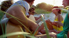 Multi ethnic people enjoying party with guitar and relaxing on beach vacation Arkistovideo