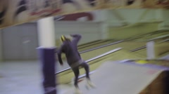 Young roller skater make jump. Slip on fence. High speed. Audience. Competition Stock Footage