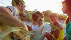 Multi ethnic people enjoying party with guitar and chilling on beach holiday Stock Footage