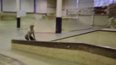 Roller skater slide on springboard, then jump on fence. Cameraman. Competition Stock Footage