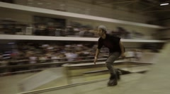 Roller skater in hat slide on fence, turn over. Audience. Competition in - stock footage