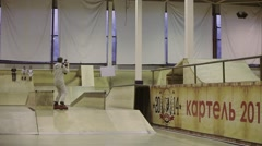 Roller skater slide on fence, turn over, lose balance. Cameraman. Competition in - stock footage
