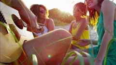 Multi ethnic people enjoying party with guitar and relaxing on beach holiday Stock Footage