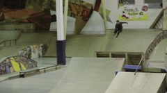Roller skater jump, grab foot in air, roll springboard. Extreme competition in Stock Footage