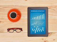 Tablet with business strategy - stock photo