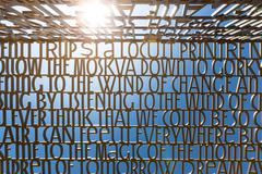 bible verses text sculpture, gardens of the world - stock photo