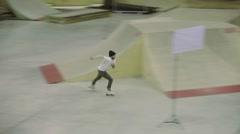 Roller skater make extreme flip, get spill. Cameraman. Competition in skatepark Stock Footage