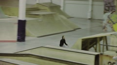 Roller skater make 360 flip, grab foot in air. Extreme flip on springboard Stock Footage