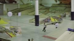 Roller skater slide on fence, fell on floor on knees. Competition in skatepark Stock Footage