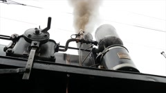 Heavy black metal boiler of steam engine locomotive Stock Footage