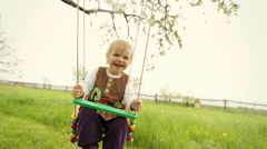 Amazing little kid swinging on teeterboard Stock Footage