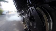 Black steel wheels of steam engine locomotive in motion Stock Footage