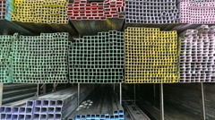 Steel pipe and steel beam and construction material on shelf in warehouse Stock Footage
