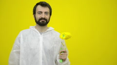 Young happy man is gesturing with a yellow paint roller Stock Footage