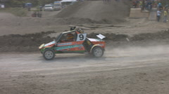Athletes on Race Cars Participating in the Rally Buggies on the Dusty Hilly Stock Footage