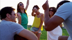 Multi ethnic students having fun at party on beach vacation Stock Footage
