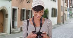 Woman with camera taking photo on Venice Italy city street Stock Photos