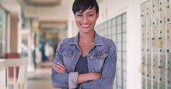 Happy smiling black woman in city post office - stock photo