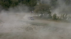 Red Racing Car Passes a Turn at High Speed in the Rally on a Dusty Road. Arkistovideo