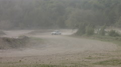 Professional Pilots of Racing Cars Are Driving in the Rally on a Dusty Road. Stock Footage